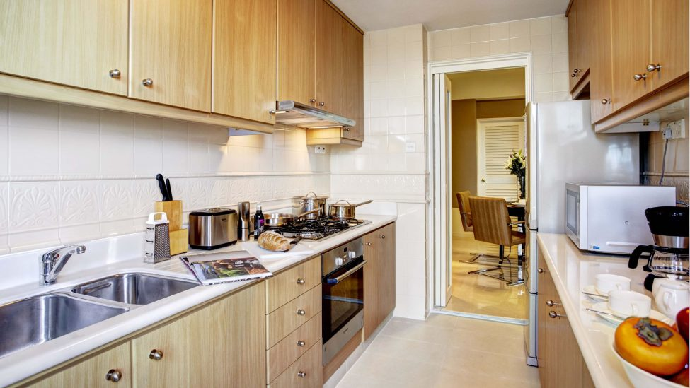 fully equipped kitchen of three bedroom grand holiday apartments singapore