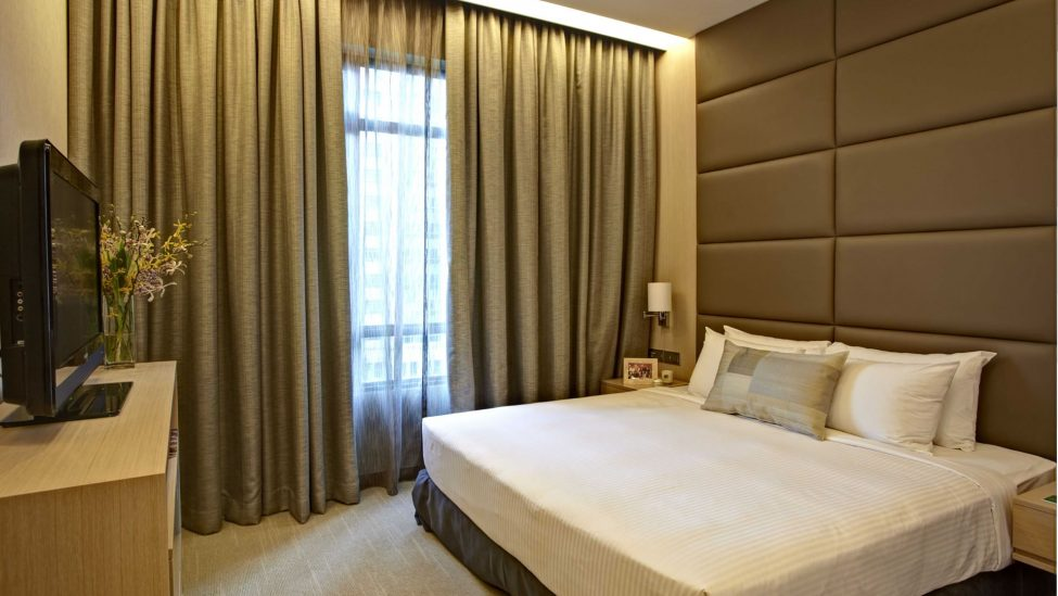 bedroom of one bedroom premier service apartments in singapore for a week lease